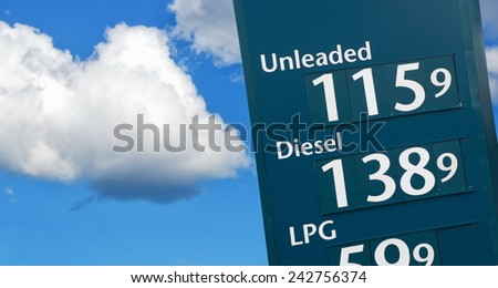 petrol prices on the fuel station - stock photo