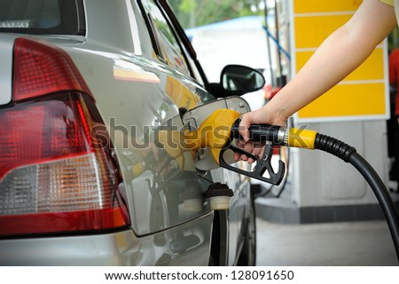 Petrol pump filling - stock photo