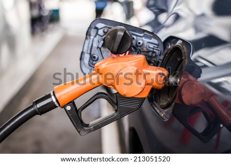 Petrol pump filling at gas station