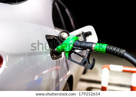 Petrol pump filling.Refuel from gas station with modern nozzle - stock photo