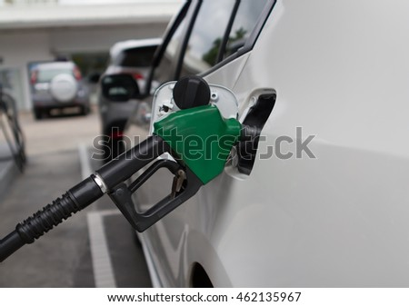 Petrol pump filling the car wite fuel in petrol stations