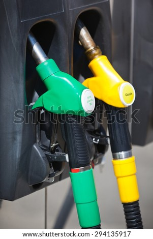 Petrol pump nozzles in a service station