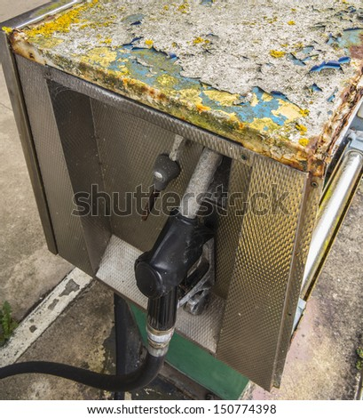 petrol pump with signs of bad decay - stock photo