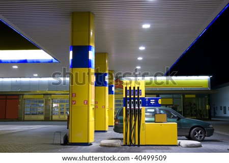 Petrol station at night in Berlin. - stock photo