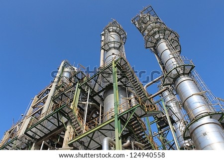 Petroleum and chemical plant with blue sky - stock photo