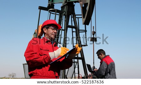 Petroleum Engineers Teamwork Petroleum Engineers Work Stock Photo