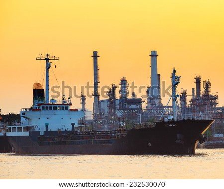 petroleum gas container ship and oil refinery plant industry estate behind use for petrochemical industrial topic  - stock photo
