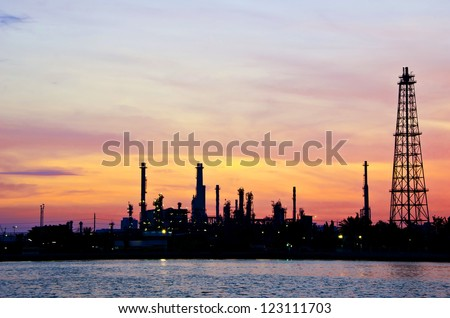 Petroleum oil refinery factory over sunrise in Bangkok, Thailand