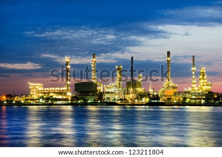 Petroleum oil refinery factory over sunrise in Bangkok, Thailand - stock photo