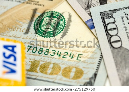 Petropavlovsk, Kazakhstan - APRIL 7, 2015: Photo of VISA credit card with american dollars - stock photo