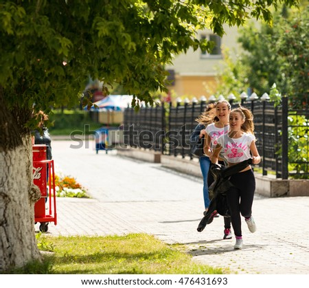 Petropavlovsk, Kazakhstan - August 30, 2016: Fitness, sport, healthy lifestyle concept - group of happy teenage friends or sportsman, outdoors street. Kazakhstan marks Constitution Day.