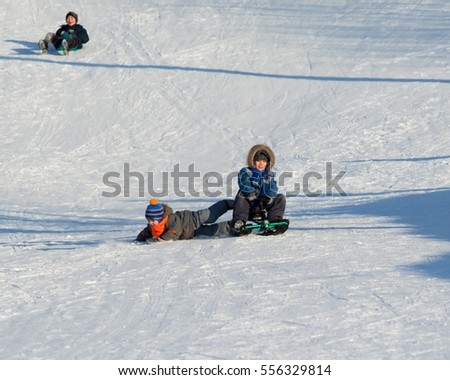 PETROPAVLOVSK, KAZAKHSTAN- January 15, 2017: Children in the winter and ride  in the snow, Kazakhstan, a sports vacation.