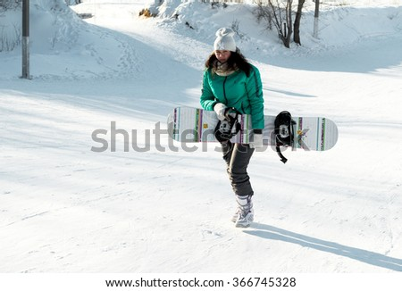 PETROPAVLOVSK, KAZAKHSTAN- JANUARY 24, 2016: Snowboard ride from the mountain in a forest in a recreation center in Kazakhstan