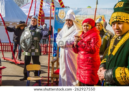 PETROPAVLOVSK, KAZAKHSTAN - MARCH 21, 2015: celebration of the new year on the solar calendar astronomical in Iranian and Turkic peoples. People in the national historical costumes
