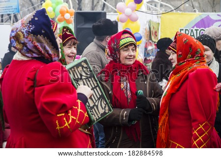 PETROPAVLOVSK, KAZAKHSTAN - MARCH 21, 2014: Muslim new year celebration. Women in traditional Russian costumes
