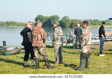 "Petropavlovsk, Kazakhstan - May 28, 2016: ""Day Card"", participating fishermen holiday organization and press on Lake Motley, Petropavlovsk Kazakhstan. Fisherman's Day."