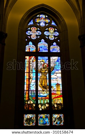PETROPOLIS,  RIO DE JANEIRO / BRAZIL- August 20, 2015: stained glass backlight - interior of Petropolis Cathedral - describe St. Peter of Alcantara - Imperial City patron - stock photo