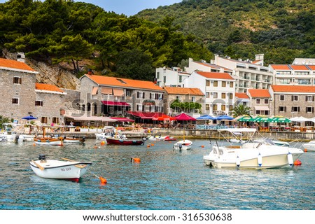 PETROVAC, MONTENEGRO - AUG 13, 2015: Petrovac resort on coast of the Adriatic sea. Adriatic sea has a catchment area of 235 000 km2