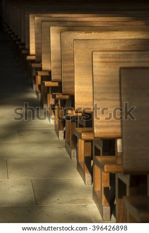 Pews in the morning light in a historic church in the Netherlands - stock photo