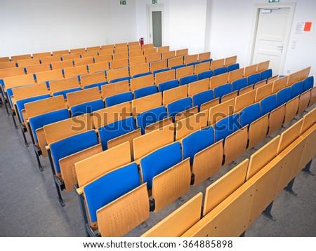 Pews in the seminar room at university - stock photo