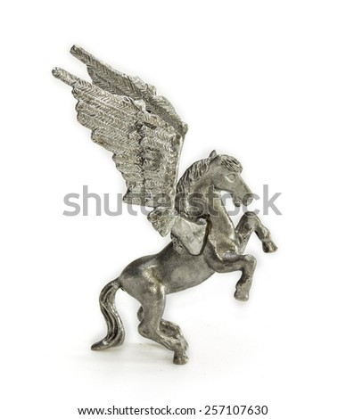 Pewter figurine of Pegasus on a light background - stock photo