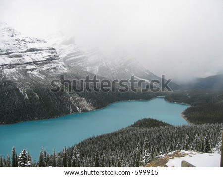 peyto lake in the canadian rockies just after a fall snowstorm - stock photo