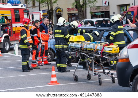 PEZINOK, SLOVAKIA - MAY 8, 2016: Volunteer fire fighters participate in a vehicle extrication demonstration and training in Pezinok, Slovakia - stock photo