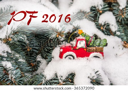 PF 2016 - Christmas holiday celebration concept with snow and Christmas tree on toy car - stock photo