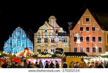 PFAFFENHOFEN, GERMANY - DECEMBER 21: People at a traditional bavarian christmas market in Pfaffenhofen, Germany on Dezember 21, 2014. Foto taken from Hauptplatz. - stock photo