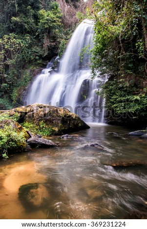 Pha Dok  Seaw waterfall or Rak Jang waterfall in Doi Inthanon National Park,Thailand,Most Famous in Thailand, Beautiful silky waterfall flow through stones. - stock photo