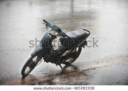 Phan Thiet Vietnam, September 5, 2012 : motorbike in the rain