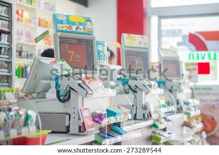 Phang Nga, 21 october 2014: 7-Eleven shop with cash desk at gas station in Phang Nga town, Phang Nga province, Thailand. - stock photo