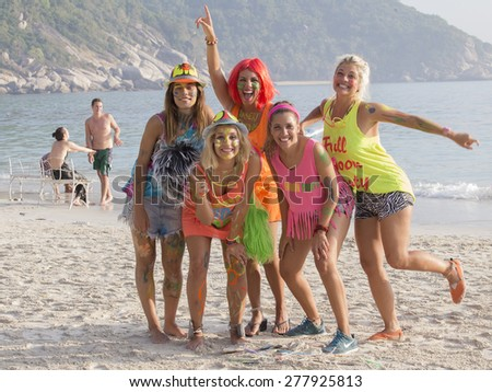 PHANGAN, THAILAND - JANUARY 5, 2015: Unidentified young girls participate in the Full Moon party on island Koh Phangan. The event now attracts about 40,000 party-goers every month