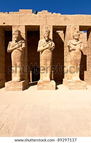 Pharaoh statues in ancient Karnak temple, Egypt - stock photo