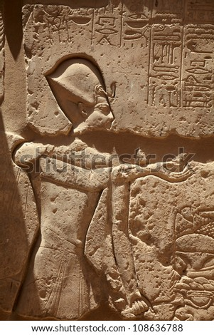 Pharaons figure on the wall in Karnak Temple - stock photo