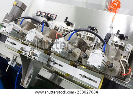 pharmaceutical factory production equipment closeup - stock photo