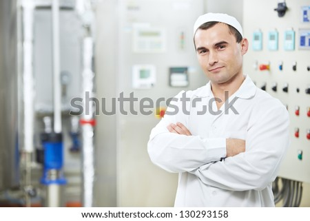 pharmaceutical man worker in water preparation production line hall at pharmacy industry manufacture factory - stock photo