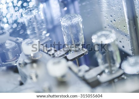 pharmaceutical medicine industrial washer cleaning and drying machine for powder drugs glassware bottles. Shallow DOF - stock photo