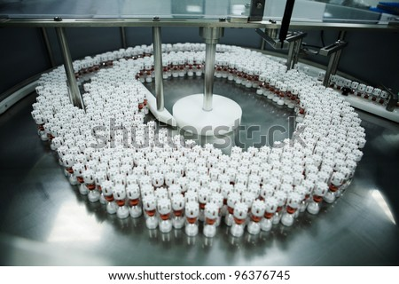 pharmaceutical plant medicament being packaged - stock photo