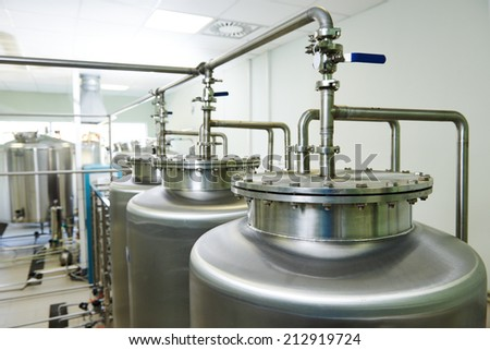 Pharmaceutical technology equipment tank facility for water preparation, cleaning and treatment at pharmacy plant - stock photo