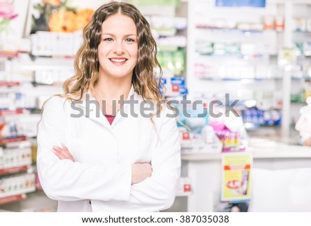 Pharmacist portrait. Woman working in a pharmacy. concept about service and health care - stock photo