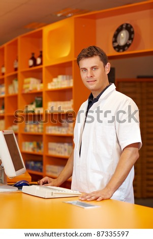Pharmacist serving behind the counter of a pharmacy
