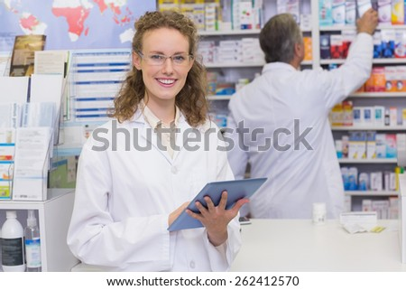 Pharmacist using tablet pc at the hospital pharmacy
