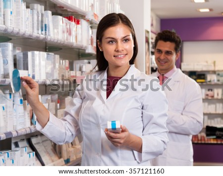 Pharmacist woman in a white coat at the chemists shop
