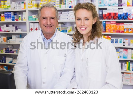 Pharmacists looking at the camera in the pharmacy