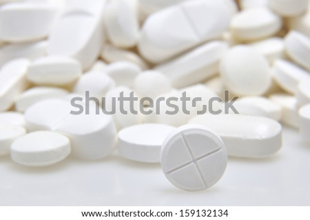 Pharmacy background, Heap of white round medicine tablets - stock photo