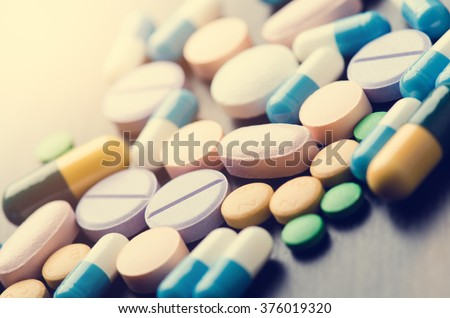 Pharmacy background on a black table. Tablets on a black background. Pills. Medicine and healthy. Close up of capsules. Different kind of medicines - stock photo