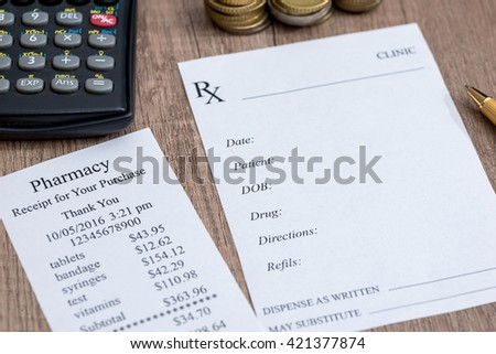 Pharmacy receipt , calculator, coin and pen on wooden - stock photo