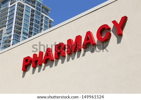 Pharmacy sign on building - stock photo