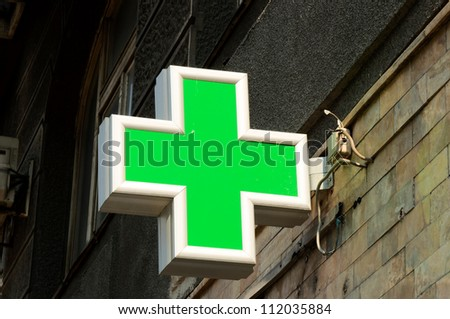 Pharmacy sign on the street - stock photo